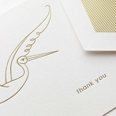 Put recipients in fine feather with these finely wrought thank you notes. A gold stork swirling on white tucks tidily into a gold and white stripe-lined envelope.