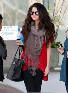 selena gomez: red tee with brown cowl neck scarf and a classic bag.