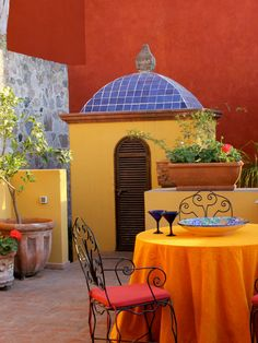 Colorful Terrace An orange tree and geraniums dress up this colorful Mexican-inspired terrace.