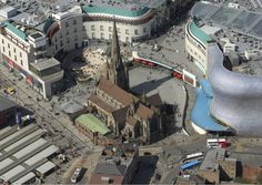 Bull Ring, Birmingham, England, featuring St Martin's church (centre) and the silver Selfridges store. Photo taken by the West Midlands Police helicopter during routine operations. Birmingham Airport, Birmingham City Centre, Birmingham Selfridges, 1960s Britain, Great Britain, Future Systems, Birmingham England, 2nd City, Interesting Buildings