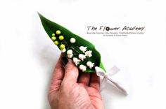 Lily of the valley jacket brooch. Poisonous in nature, but not made of polymer ;) http://www.polypediaonline.com/polymer-clay-tutorials-life-like-flowers-polypediaonline.html