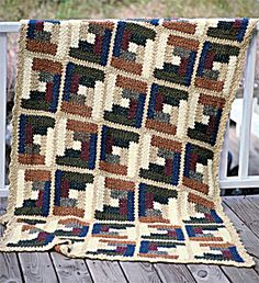 Homespun Log Cabin Afghan  Bring the rustic charm of a log cabin to your home, with the rich texture and woodsy colors of this Homespun afghan. 48 inches x 70 inches