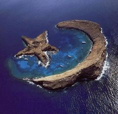Sound kind of hard to believe. Island of Molokini - natural star and crescent - between Maui and Kahoolawe, Hawaii