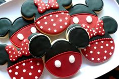 Mickey Mouse and Minnie Mouse decorated cookies.  Minnie's bow is a royal icing transfer.  www.facebook.com/cookiesbycharity