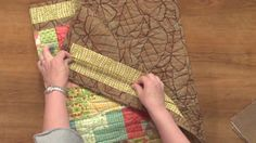 Watch each step on how to make a quilt sleeve successfully and learn how to attach a sleeve to hang your quilt for display.