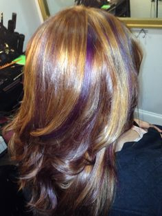 Brown hair with blonde and purple highlights!