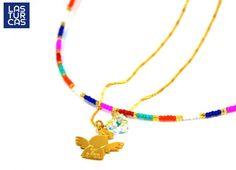 Collar elaborado en chaquiras multicolor con corazón de Swaroski boreal y…