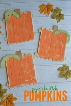 DIY Popsicle Stick Pumpkins. Use wooden craft sticks, Elmer's Glue, paint, and colored paper to make cute pumpkins with your kids.