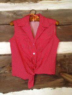 Hey, I found this really awesome Etsy listing at https://www.etsy.com/listing/175867390/vintage-polka-dot-blouse check out my shop! :)