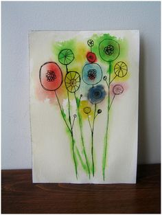 drop watercolor on wet paper, let dry, then draw your flowers on top of the color!