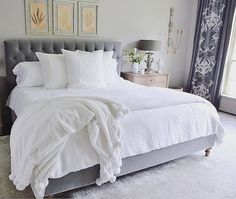 Gold prints and grayscale accent paired with fresh white bedding, take a tip in dreamy design a la @decorgold | Get ready-to-shop #LTKhome details with www.LIKEtoKNOW.it | http://liketk.it/2pkcT #liketkit