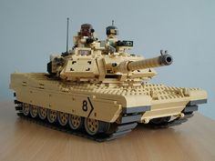 Ralph Savelsberg gets ready to put the hurt on with this gorgeous rendition of the Abrams. Can I use the word 'gorgeous' to describe a tank? Lego Ww2, Lego Design, Lego Technic, Technique Lego, Construction Lego, Lego Boards, Lego Craft, Lego Mecha, Cool Lego Creations