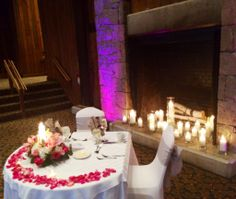 Dramatic uplighting + warm candles + rose petals = a fantastic sweetheart table at Timbers, one of the wedding venues at the Heritage Resort and Conference Center, Southbury, CT