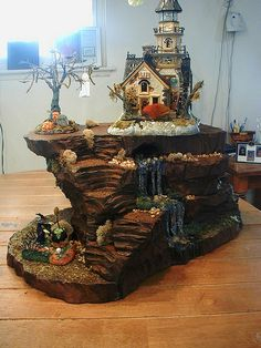 This miniature hill features a great waterfall and was designed with plenty of room for me to display not only a good sized building on the top platform, but also a few larger accessories.  This was one of my favorite pieces.  That's probably why I took so many photos of it.