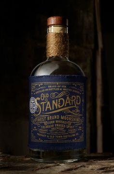 Chad Michael Studio - Old Standard Moonshine - World Packaging Design Society / 世界包裝設計社會 / Sociedad Mundial de Diseño de Empaques Whiskey Label, Whiskey Brands, Beer Label, Whiskey Bottle, Rum Bottle, Wine Labels, Beverage Packaging, Bottle Packaging, Brand Packaging