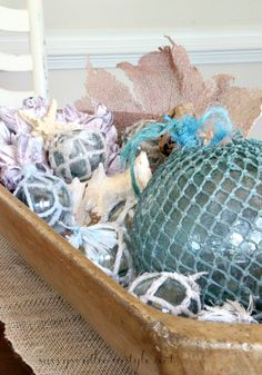 Savvy Southern Style: Summer Open House Tour/ dough bowl filled with shells, coral, seafans and floats