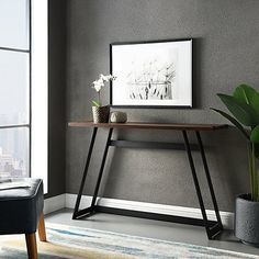 This Urban Metal Wrap Dark Walnut Console Table is the perfect choice for achieving an effortlessly industrial and utilitarian aesthetic in your living space. Hallway Console, Foyer, Entryway Tables, Slim Console Table, Modern Console Tables, Modern Table, Walnut Furniture, Living Room Designs, Living Room Furniture