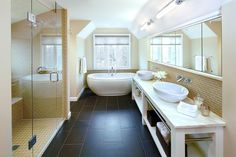 Spacious Bathroom with White Wall and Ceiling Decorated with Black Bathroom Floor Tiles and Cream Wall Tiles Black Bathroom Floor Tiles, Bathroom Flooring, Tile Flooring, Bathroom Interior Design, Home Interior, Interior Decorating, Decorating Ideas, Cleaning Porcelain Tile, Porcelain Tile Cleaner