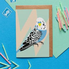 Printed in the UK on high quality FSC paper Plastic wrap is recyclable Part of Lorna's flora and fauna collection #cards #budgie #birds #illustration Blue Budgie, Brown Envelopes, Bird Cards, Geometric Background, Budgies, Writing Paper, Bird Design, Cool Cards