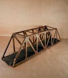 how fun is this?  if i had a boys room to decorate, or an engineers office... Antique Rusty Metal Truss Bridge, Rustic Industrial Object, Trestle Bridge for Toy Trains. $75.00, via Etsy.