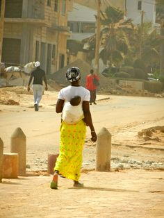 A Mom carrying her baby tied onto her back...Dakar, Senegal.