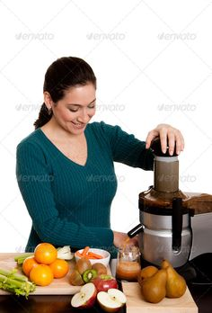 Buy Woman making fruit juice by phakimata on PhotoDune. Beautiful woman in kitchen making fresh squeezed organic juice using a juicer, isolated. Best Juicer To Buy, Juicing Benefits, Health Benefits, Juice Diet, Fruit Juice, Citrus Juicer, Juicing For Health, Healthy Smoothies, Detox Smoothies