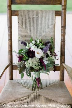 Beautiful country chic hand tied bouquet of summer garden and wild flowers. Soft white Lisianthus, Queen Anne's Lace and Seeded Eucalyptus paired with Hypericum Berries, Wax Flower, and purple Veronica....perfection. designed by Alice @ Mount Williams Greenhouses Photo by Summer Street photography