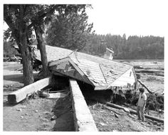 Rapid City Flood Aftermath - Roof Deposited on Stone Wall from the BHKN Digital Archives