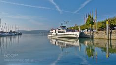 Morning at Radolfzell Harbour by achimbitzer with morninglakewaterreflectionGermanyShipReichenauBodenseeLake of ConstanceRadolfzell