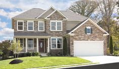 This spacious Darby home in New Market, MD, features a beautiful stone front and an inviting covered porch. The popular Richmond American plan also includes abundant windows encased in bright white trim and a convenient 2-car garage.