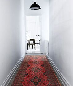 Hallway with an awesome rug.