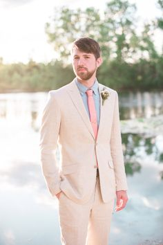 all linen groom look with blue collard shirt and coral tie