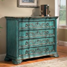 I stumbled across this MUST HAVE for my foyer and I absolutely love it! My living room, with base colors of browns and golds, now has accents of teal to tie it all in. So fun!!
