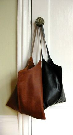 distressed leather wedge tote from scabbyrobot (etsy) http://www.etsy.com/shop/scabbyrobot