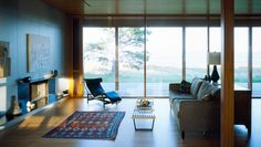 floor to ceiling windows in a sun room / green room