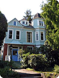Blue Victorian house with turret