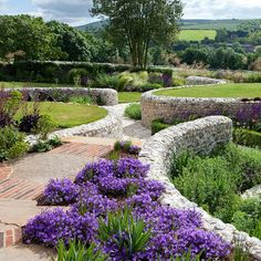 Ian Kitson Landscape architect. Very interesting landscape design with both retaining and free standing walls worked into the land.