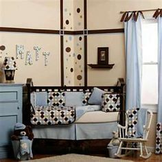 dark wood, baby blue, cream, and brown.  I painted Aethyn's room like this in a light chocolate brown wall w/ dark brown stripes and drk brown, teal and green spots...I love how his walls turned out!  My mom made all his bedding to match!