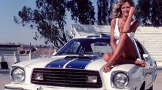 "1976 - Charlie's Angel Farrah Fawcett aka ""Jill Monroe"" not only made her hairstyle popular, but this 1976 Mustang II Cobra II became a classic."