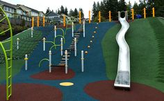 A playground built into the side of a hill, now that is brilliant! The Queenston Park playground is in Coquitlam (north of PoCo on Burke Mountain).