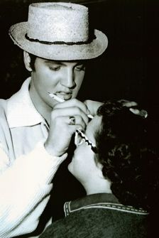 Elvis 1957 autographing a fans forehead .. if it had been me I would never ever have washed it off!
