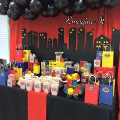 Cool dessert table at a superhero birthday party! See more party planning ideas at CatchMyParty.com!