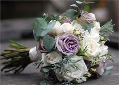 A mix of roses, wax flower and silver green foliage... Romantic and pretty but not sugary!