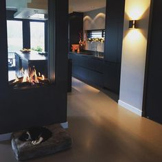 black kitchen with fireplace House Inspiration, House Design, Fireplace Design, Sweet Home, Bungalow Design, Home Decor, House Interior, Freestanding Fireplace, Home Deco