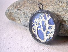 Pressed flower and Lichen circle Glass soldered terrarium pendant, via Etsy.