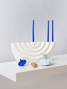 This new menorah from Studio Armadillo with wavy pattern of folds, is a tribute to the iconic Menorah of the temple. The menorah's white clean design, initially created in paper and then transformed to ceramic molds, is a renovated look of a most. Hanukkah Crafts, Hanukkah Candles, Feliz Hanukkah, Hanukkah Decorations, Hanukkah Menorah, Happy Hanukkah, Hanukkah Traditions, How To Make Light, Candlesticks