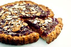 Raspberry Bars with Almond Crust/Trained by a Medicine Man on Martha's Vineyard. From Orange Peel Bakery One Baker Gives Rise to an Honest Community http://www.nytimes.com/2015/07/23/t-magazine/recipe-raspberry-bars-orange-peel-bakery.html