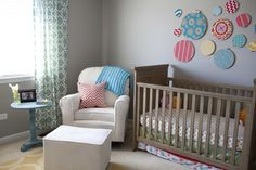 The embroidery hoop collage is a colorful, whimsical accent in this nursery!