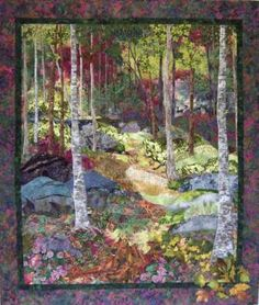 "Fiber Art Quilts-Landscape. ""Hiding in the Shadows"" 48 x 42 inches This woodland scene is based on a photo taken in the Smokey Mountains. The quilt is raw edge applique and thread painted using numerous colors of rayon thread. Also, hiding in the scene are several animals & insects--deer, rabbits, squirrels, a pheasant, lady bug, butterflies and a field mouse."