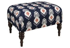 June Ottoman, Blue/Orange : Featuring an ikat design with global appeal, this clean-lined ottoman adds a little interest to the living room. Use it as a footrest or an extra seat, or top it with a tray to use as a table. [I've seen DIY's to active this look too.]